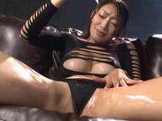 Oiled up Reiko Kobayakawa shows her big tits and masturbates