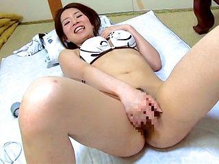 Busty seductress Miho Uemura masturbates her kitty
