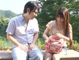 Busty Asian teen Ai Nakaidou fucking in the park picture 2
