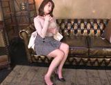 Alluring Japanese chick pokes pussy with a sex toy picture 14