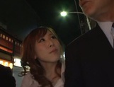 Horny redhead Erika Kitagawa pleases cocks of two horny guys