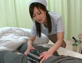 Nurse in fishnet stockings Sayuki Kanno makes tit fuck picture 11