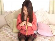 Mai Uzuki Asian doll rubs her pussy with a dildo