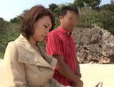 Rear fuck with Reiko Nakamori outdoors on the beach picture 1