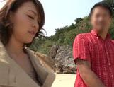 Rear fuck with Reiko Nakamori outdoors on the beach picture 3