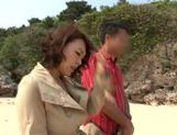 Rear fuck with Reiko Nakamori outdoors on the beach picture 4