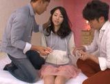 Skinny Japanese seductress Tsubasa Yuzuki is fucked by two dudes