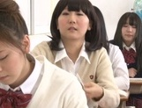 Yummy Japanese lesbian teens involve a classmate into a kinky game picture 3