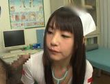 Tsubomi naughty Asian nurse gives double blow jobs