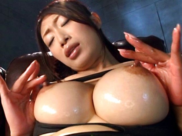 Oiled up Reiko Kobayakawa shows her big tits and masturbates