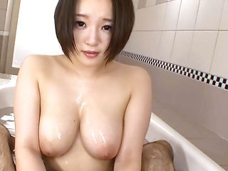 Japanese AV model gets big tits licked and fucked in the bath