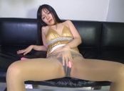 Captivating Asian milf in nylon stockings drills pussy with sex toys