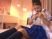 Naughty Asian teen in school uniform fingers her wet pussy