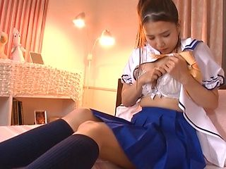 Savory schoolgirl in uniform masturbates and squirts