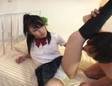 Mina Asian schoolgirl gives a footjob