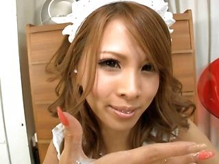 Adorable Japanese babe Ema Kisaki likes giving handjobs