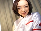 Rina Yuuki Hot Japanese nurse spreads her legs picture 1