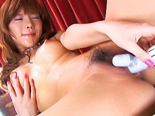Serina Hayakaw Asian model is poking her hairy pussy with a dildo