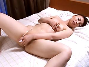 Talented Japanese lady Midori Takashima rubs her pussy and anal