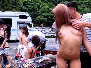 Naughty Asian milf and horny teen chick in hot outdoor group sex