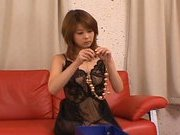 Sakurako Asian doll masturbates her hairy snatch