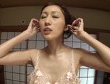Slender Japanese mature chick Julia makes footjob and titfuck