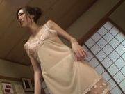 Slender Japanese mature chick Julia makes footjob and titfuck