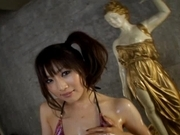 Akari Satsuki Asian babe covered in oil for a threesome