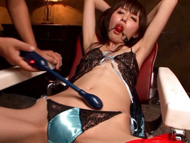 Yui Igawa in fishnet stockings enjoys toy insertion