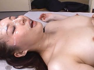 Yui Tatsumi nasty Asian milf gets bukkake facial