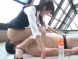 Naughty Asian office lady Shizuku Memori gives a cute foot job