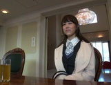 Naughty Asian office lady Shizuku Memori gives a cute foot job