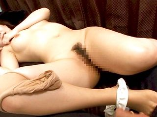 Cute Japanese lady makes a footjob and handjob and gets banged