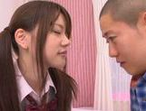 Young Rina Osawa likes having her pussy stretched