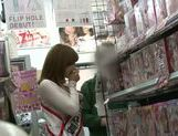 Naughty Japanese salesgirl Yui Akane makes a handjob picture 1