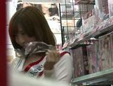 Naughty Japanese salesgirl Yui Akane makes a handjob picture 9
