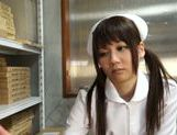 Pigtailed Japanese nurse Yurika Miyaji performs arousing wank picture 2