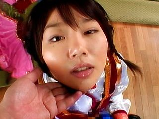 Lovely Japanese model gets a load of cum on her face