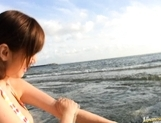 Yuma Asami Asian babe shows off her hot body on the beach