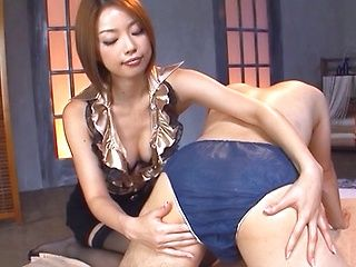 Sexy Tokyo milf licks balls and bounces on stiff pecker