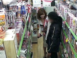 Tempting Japanese milf Yui Akane gives hand job in public