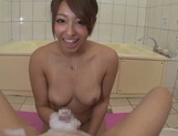 Japanese model plays naughty with a stiff cock picture 12