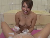 Japanese model plays naughty with a stiff cock