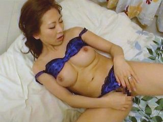 Spicy Japanese milf in fancy lingerie gets her kitty creamed