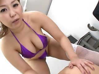 Busty Tokyo chick Naho Hazuki teases cock and fondles it with tits