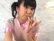Pigtailed Japanese teen Rino Nanse makes erotic massagejapanese pussy, japanese sex}
