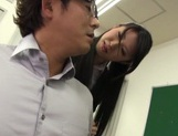 Horny Asian female teacher seduces her male colleague and gets fucked picture 13