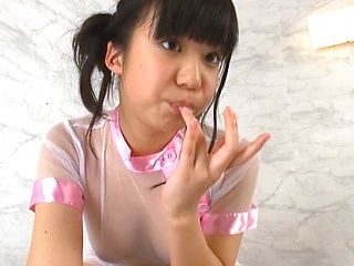 Pigtailed Japanese teen Rino Nanse makes erotic massage