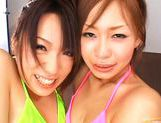 Hot Asian Kanako and friend get a jizz bomb while they are French kissing picture 12