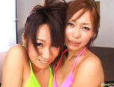 Hot Asian Kanako and friend get a jizz bomb while they are French kissing picture 13